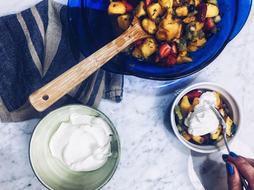 fruit salad, salad, fruit, whip cream, homemade, snack, dessert, spring, summer, side dish, strawberry, blueberry, mango, kiwi, herbs, thyme, basil, mint, lemon