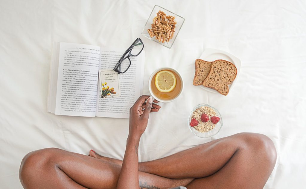Person in bed - The Basics - Tips to Improve your Airbnb Ranking