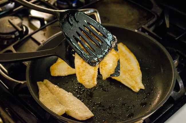 Flip fish for Fast Fish Dinner with Herbed Browned Butter by using two spatulas, on underneath and on on top to steady the fish and keep it from falling apart when flipped over.