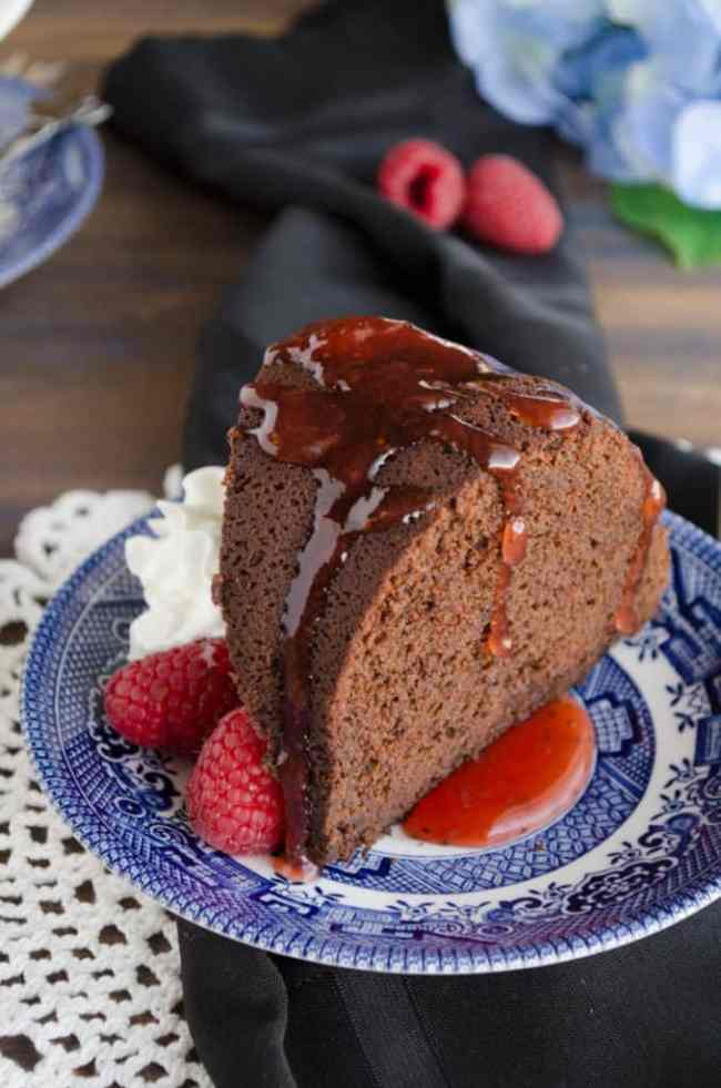 A close up of a slice of Chocolate Raspberry Bundt Cake. - The Goldilocks Kitchen