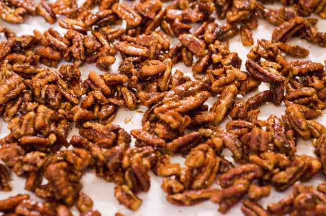 Candied Spice Pecans cool on parchment paper - The Goldilocks Kitchen