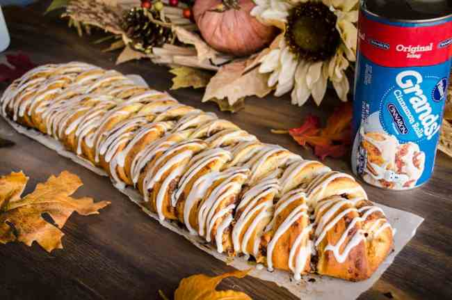 A Pumpkin Pie Breakfast braid shown with an unopened can of Original Pillsbury Grands! Cinnamon Rolls - The Goldilocks Kitchen