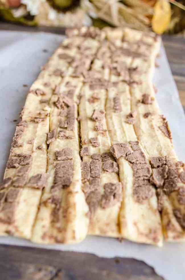 Cinnamon rolls unrolled create long strips of dough covered with filling for making a Pumpkin Pie Breakfast braid - The Goldilocks Kitchen