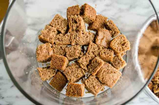 Spice cake cubes fill the bottom of a trifle bowl for Pumpkin Spice Cheesecake Trifle - The Goldilocks Kitchen