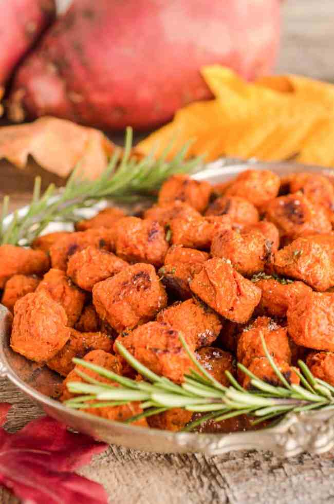 Several Sweet Potato Tater Tots sits on a silver tray garnished with rosemary sprigs - The Goldilocks Kitchen
