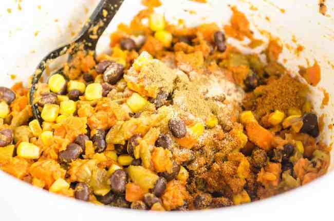 Mashed Sweet potato is mixed with black beans, green chile, corn and spices to make filling for Black Bean Sweet Potato Enchiladas - The Goldilocks Kitchen