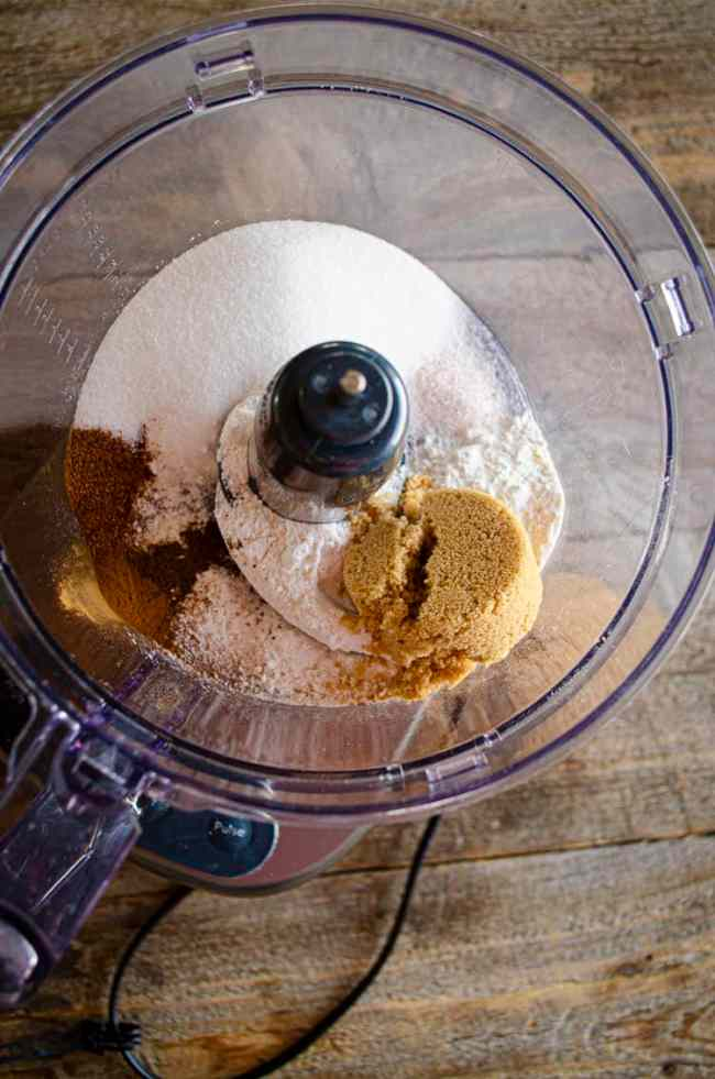 Looing down into the bowl of a food processor filled with the ingredients for the Ginger-Pear Crisp topping.