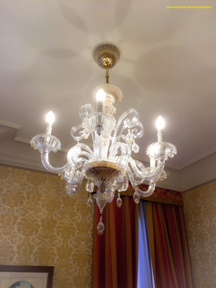 The chandelier in the room of Hotel Antiche Figure Venice