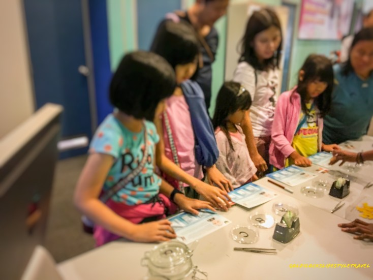 Learning about water ph level in Science Center Singapore