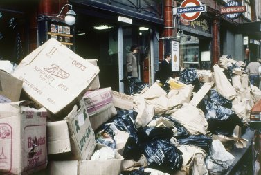 Trash piles up in London during labor strike in 1970s.