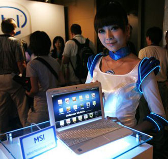 (Photo, courtesy of the Associated Press, by Wally Santana)  A model displays a MSI laptop containing Intel Corporations new Atom chip at Computex Taipei, the biggest information technology trade show in Asia, in Taipei, Taiwan, Tuesday, June 3, 2008.