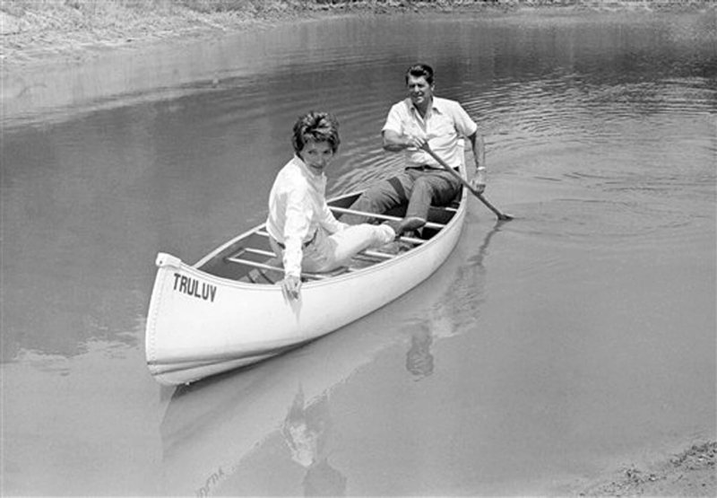 Ronald Reagan took his wife Nancy for a canoe ride on a pond at their mountain ranch near Santa Barbara, Calif., on July 27, 1976. Reagan announced in Los Angeles that he had selected liberal Republican U.S. Senator Richard S. Schweiker as his vice presidential running mate if nominated at the GOP National Convention in Kansas City in August. (AP Photo/Walter Zebowski)