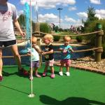 The Allen triplets enjoying a game of mini golf
