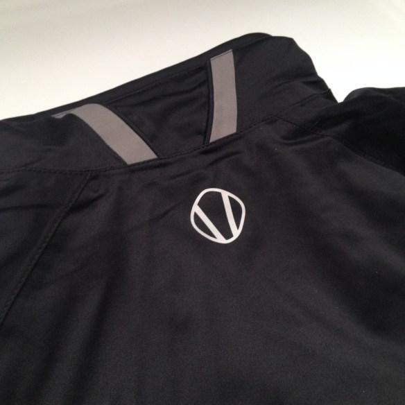 V collar with neoprene finish.