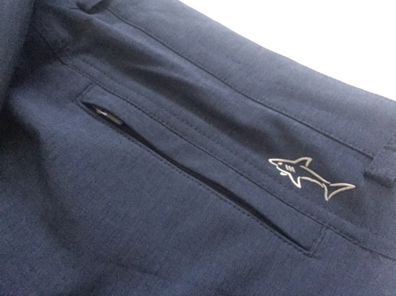 Reflective logo and zippered rear pocket
