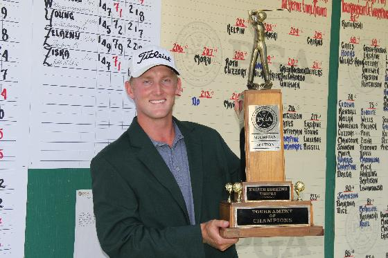 Barrett Kelpin holds the Walter Burkemo Tournament of Champions Trophy.