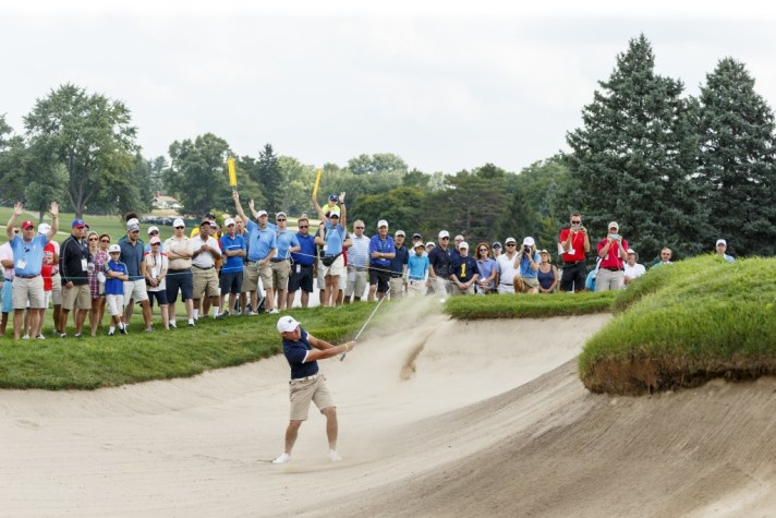 Nick Carlson blasts out of a bunker on the 17th hole during semifinal round of match play at the 2016 U.S. Amateur at Oakland Hills Country Club in Bloomfield Hills, Mich. on Saturday, Aug. 20, 2016. (Copyright USGA/Chris Keane)