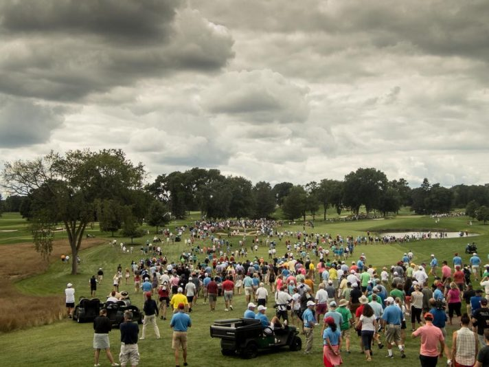 Fans following Luck and Dalke down the fairway of the seventh hole at the US Amateur.