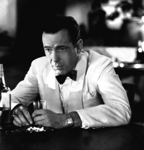 Bogart wearing a Longines Evidenza Watch