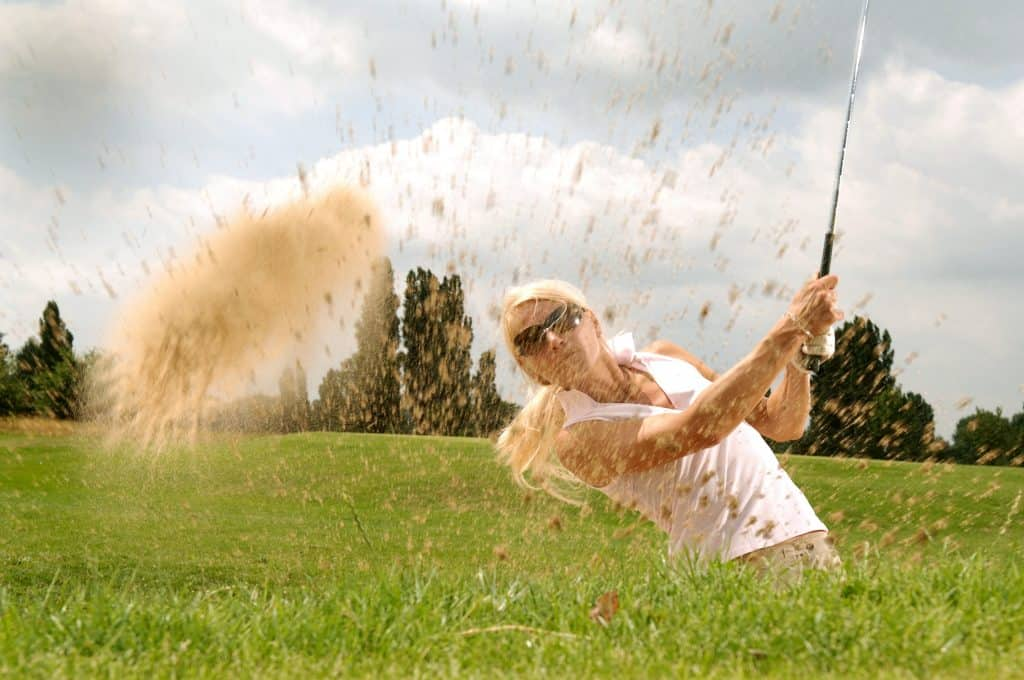 using a sand wedge from the bunker