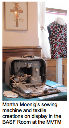 A photograph of Martha Moenig's sewing machine and textile creations, by kind permission of the Mississippi Valley Textile Museum