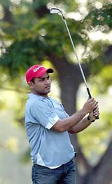 A Tribune shot of Virender Sehwag playing golf in 2005