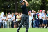 Francesco Molinari of Italy hits his second shot on the 1st hole during the fourth round of the Italian Open at Golf Club Milano
