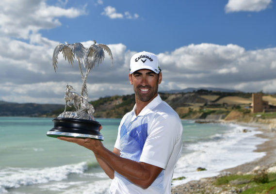 Alvaro Quiros of Spain holds the trophy after winning The Rocco Forte Open at The Verdura Golf and Spa Resort