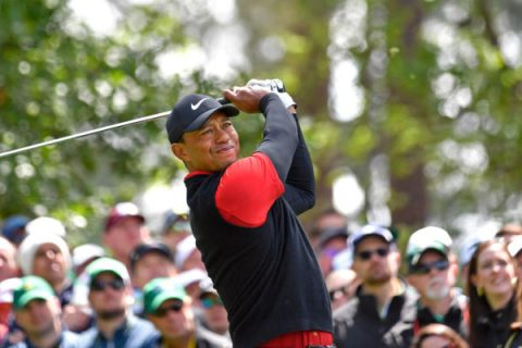 Masters champion Tiger Woods hits his tee shot on Hole No. 4 during the final round of the Masters at Augusta National Golf Club, Sunday, April 8, 2018.