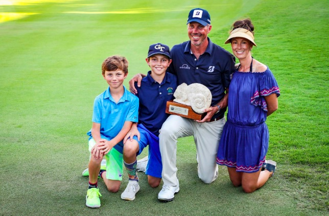 Matt Kuchar posing with his Mayakoba Golf Classic spoils along with his family