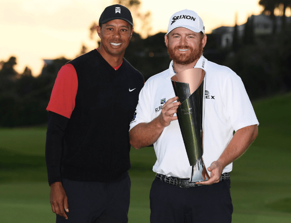 J.B. Holmes holds up his Genesis Open trophy with tournament host Tiger Woods for company