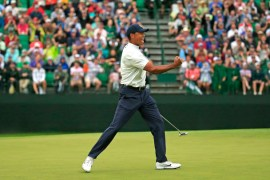 Masters champion Tiger Woods reacts to his birdie putt on No. 15 during the second round of the Masters at Augusta National Golf Club, Friday, April 12, 2019.