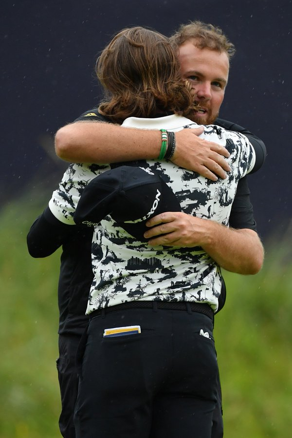 Shane Lowry embraces his rival Tommy Fleetwood on the 72nd Hole