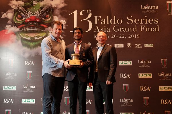 Keshav Mishra is congratulated by Sir Nick Faldo after winning the Under-21s at last year's Faldo Series Asia Grand Final.