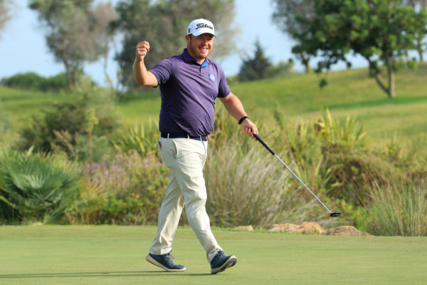George Coetzee of South Africa celebrates victory on the 18th green during Day Four of the Portugal Masters at Dom Pedro Victoria Golf Course (Photo by Andrew Redington/Getty Images)