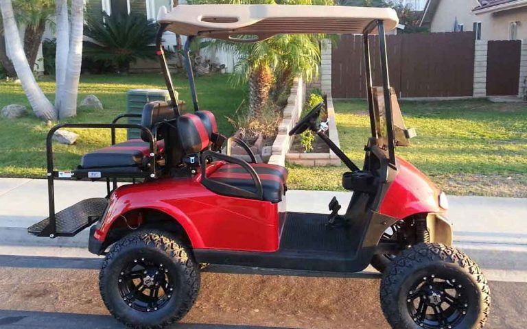 red slightly lifted golf cart