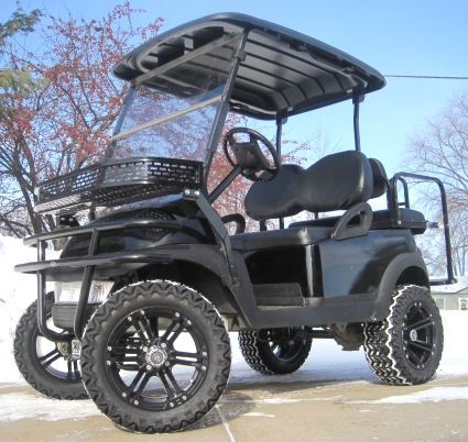 all black lifted golf cart with custom rims