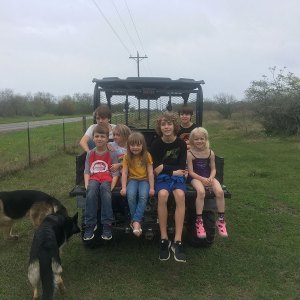 Photo of grandnephews and grandnieces plus a friend and dogs Oso and Maya after visiting the farm to see our fish.