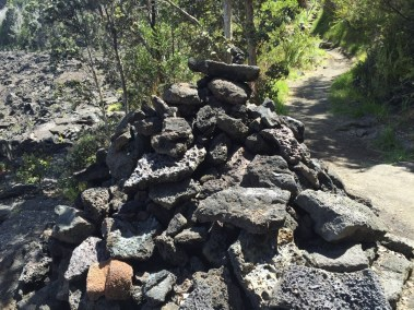 "an ""Ahu"" rock pile that marks the trail on the lava lake bed"