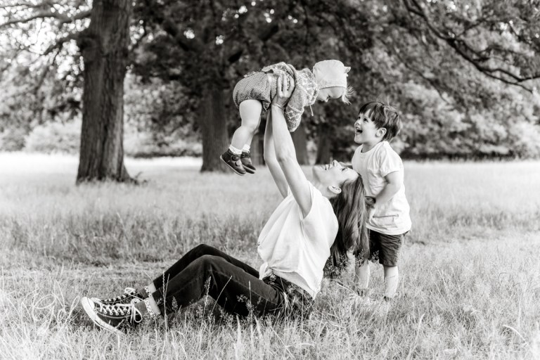 mum and children, playing outdoors in the park