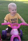 SHORT haircut on his sister's big wheel