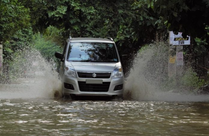 WagonR driving through water