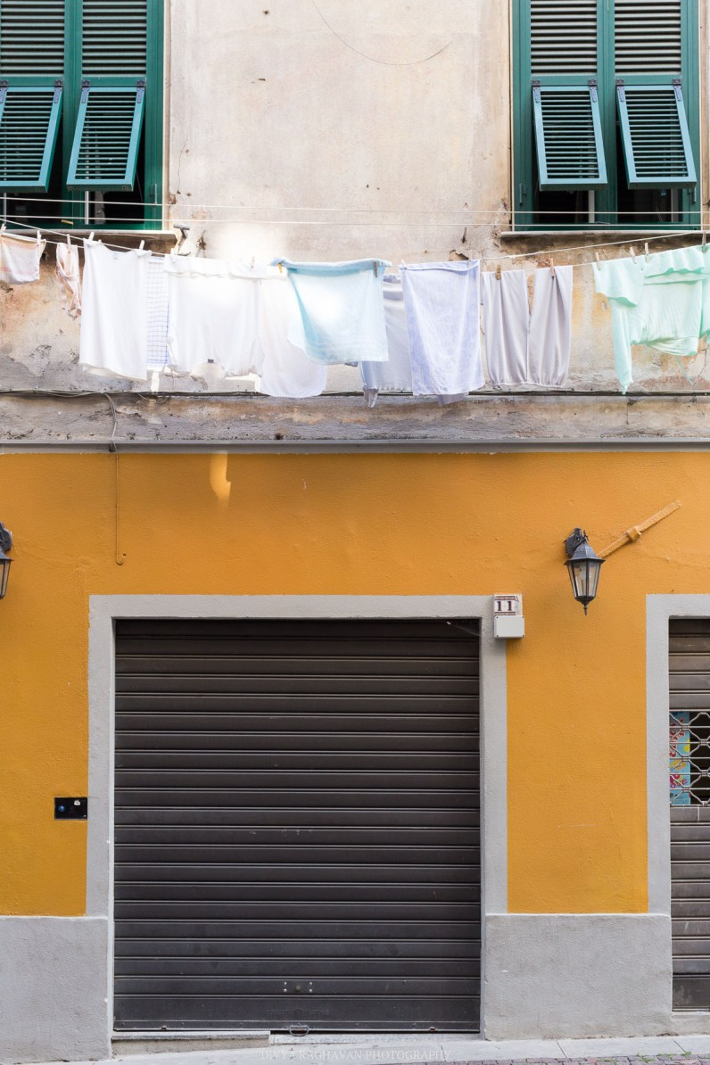 Colorful facades and hanging laundry at the old town // A day trip to the medieval town of Ventimiglia, Italy from Nice, France // gonewithawhim.com