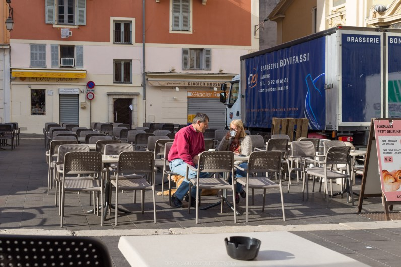 Couple enjoying at the terrace of Cafe Antonio, Place Rosetti    Early mornings in the old town of Nice, South of France