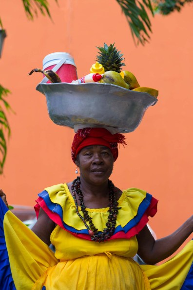 Palenquera and her delicious fruits, Cartagena, Colombia, South America -- Photos to inspire you to visit Colombia -- Gone With a Whim