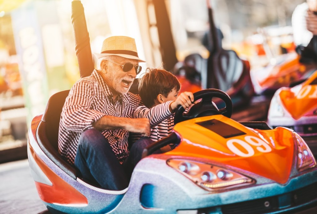 man and child in bumper cars, one of the best things to do in Myrtle Beach with kids