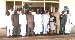 Elder Peter Kisira in a group photograph with the DG, National Boundary Commission, Dr Mohammed Ahmad and his team in Ilorin