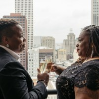 couple toasting hotel rooftop patio