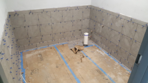 Ceramic tile underway in restrooms