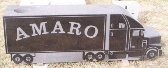 "Black granite, truck shape cut, 42"" W x 12"" H"